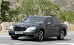 Bentley Continental Flying Spur V8 Caught in Spy Photos. For more, click http://www.autoguide.com/auto-news/2012/08/bentley-continental-flying-spur-v8-caught-in-spy-photos.html