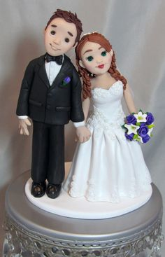 bride and groom wedding cake topper hand sculpted from polymer clay.