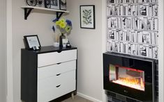 Ferny Hill Retreat's funky fireplace, topped by shelves brimming with books, is seriously unreal! Learn how it was created. Fake Fireplace, Fireplace Surrounds, Tile Wallpaper, Holiday Apartments, Unfinished Wood, Sliding Doors, Bookshelves, Filing Cabinet, Emerald