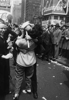 Sailor Kissing Woman on V-E Day, 1945 - BE047919 - Rights Managed - Stock Photo - Corbis. A sailor kisses a woman on the streets of New York City in celebration of V-E Day, the day of the German surrender to the Allied forces in World War II. May 8, 1945. by diann