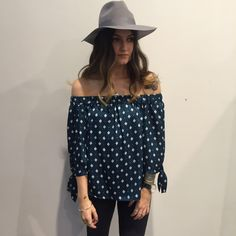 We love this shoulder-baring Bardot top, complete with geo tile print and tie sleeves for an updated look. Style it with some slim fit jeans and mules for a casual-cool vibe. #Topshop