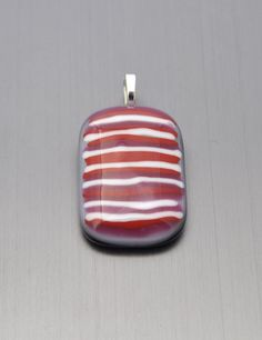 Red pink and white striped glass pendant with a wavy by Kaelay