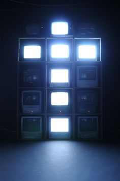 """TV typeface"" project by Jack Archer. The grid of 15 TVs shows alphabets and numbers one at a time."