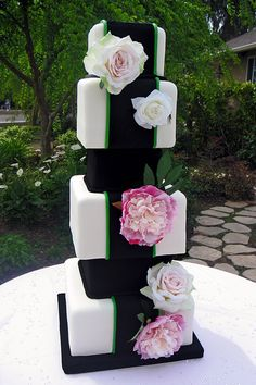 Square tier wedding cake with pink flower detail