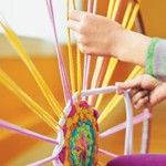 Weave a rug using a hula hoop and old t-shirts.