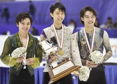 Champion Yuzuru Hanyu (center), runner-up Shoma Uno (left) and third-place finisher Takahito Mura receive their awards on Saturday after the men's free program at the All-Japan Championships in Sapporo. | KYODO