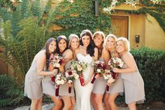 Neutral with a pop of bold color schemes.  #LaubergeDelMar #weddingtrends  Neutral bridesmaid dresses with pops of red in the bouquets. Floral design by Nancy Liu Chin, photos by Michele Waite | junebugweddings.com