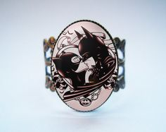 Hey, I found this really awesome Etsy listing at https://www.etsy.com/listing/183776658/batman-and-catwoman-ring-antique-bronze