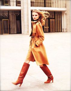 Shades of camel. Love the long coat and tall boots.