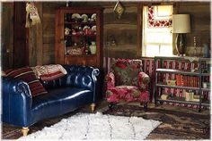 Love the wood plank walls and vintage furniture and a little chintz