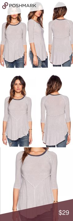 """INTIMATELY FREE PEOPLE WEEKENDS LAYERING TOP DOVE Weekends Layering Top  $40 brand new without tag, inner label marked  Style: 29490430  This lightweight sheer knit top that flows at the bottom is a great layering piece. Reverse seaming, a ribbed trim neckline, and an unfinished uneven hem that's longer in the middle complete the style.  Intimately  95% Rayon 5% Spandex Hand Wash Cold Import  Size Large: armpit to armpit flat 18"""" (has nice stretch) Free People Tops Tees - Long Sleeve"""