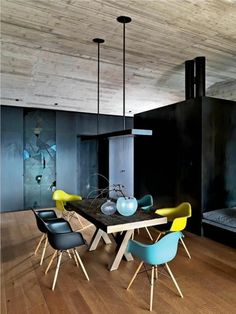 Interior Decorate Tips Why not mix and match colourful DAW Eames dining chairs, shown here in mustard, ocean and basic dark. Colored Dining Chairs, Table And Chairs, Room Chairs, Office Chairs, Swing Chairs, Lounge Chairs, Elle Decor, Home Deco, Chair Design