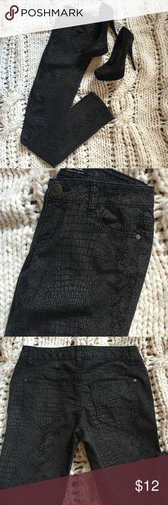 Black snake print jeans NWOT Never worn Celebrity Pink black snake skin jeans. Has subtle shimmer to them. Celebrity Pink Jeans Skinny
