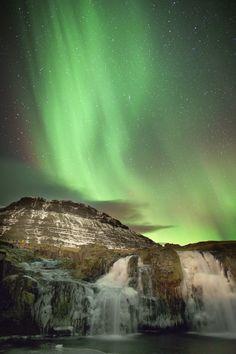 The aurora over Frozen Waterfall, Kirkjufell, Iceland