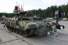 """BMPT """"Terminator"""" tank support vehicle designed by the Chelyabinsk Tractor Plant. The BMPT is equipped with two 30mm cannons, two 30mm grenade launchers, four Ataka-T tandem warhead missile tubes, and a coaxial PKT machine gun."""