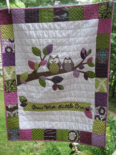 Woodland Owl baby quilt of flannel and cotton in earthy sage green, chocolate brown, deep eggplant/purple  with tree branch