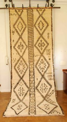 Oh my! A signed & dated (1959) Moroccan Beni Ouarain carpet. The real deal! BEAUTIFUL!  at www.redthreadsouk.com