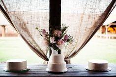 simple vase of flowers behind simple cakes