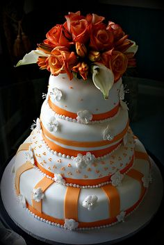 Indian Weddings Inspirations. Orange wedding cake. Repinned by #indianweddingsmag indianweddingsmag.com
