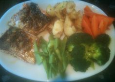 Wild Red Alaskan salmon in a soy,lemon grass,coriander,fresh ginger,garlic,virgin olive oil,honey,chili flakes sauce,with crushed new potatoes,broccoli,fresh runner beans and carrots.Heaven on a plate !