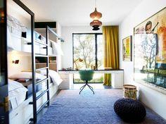 Tour Designer Sara Story's Modern Texan Ranch// vintage James Bond poster, green desk chair, bunk room