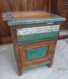 Bali recycled boat table.  (This would be cool duplicated on something using paint distressing). I love Indonesian furniture, and I think distressed pieces always add soul to a room.