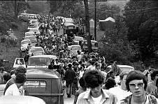 Bethel, New York:  Concert goers arriving at Woodstock Festival '69. ©Jason Laure / The Imae Works