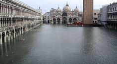 A view of a flooded Piazza San Marco, with St. Mark's Basilica in the background, in Venice, northern Italy, Monday, Dec. 1, 2008. (AP Photo/Luigi Costantini) #