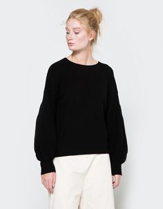 From Stelen, a sweater in Black. Featuring a round neckline, all-over rib detailing, dropped shoulder design, trumpet sleeves, straight hem and a casual fit.  • Sweater in Black • Round neckline • All-over rib detailing • Dropped shoulder design • T