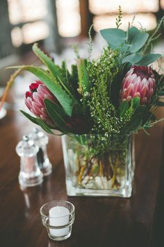 Deep Red Protea Wedding Flowers as Centrepieces | A South African Destination Wedding | Cherish Suzanne Neville Wedding Dress | Image by Illuminate Photography | http://www.rockmywedding.co.uk/cat-dan/
