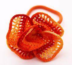 Galia Grayevsky   Jerusalem, Israel    Crochet Hair Accessory / Crochet Ponytail Holder / Crochet Flower Hair Accessory. $15.00, via Etsy.