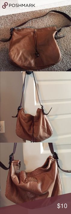Lucky brand purse Brown leather lucky brand purse. Dark brown leather adjustable straps. Has stitching and bead accents. Zipper and phone pockets. Magnetic closure. Some wear and tear at top of strap-shown in picture Lucky Brand Bags Hobos