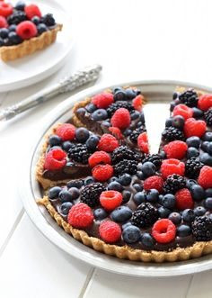 This Chocolate Berry Tart has chocolate ganache in an almond flour crust, topped with fresh berries! It is paleo, gluten-free, & vegan.