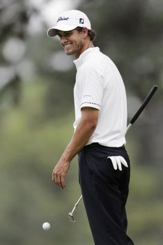 Adam Scott, from Australia, smiles on the seventh green during practice for the 2007 Masters golf tournament.