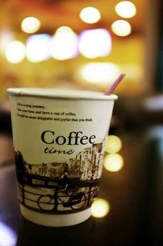 Coffee time in a paper cup.
