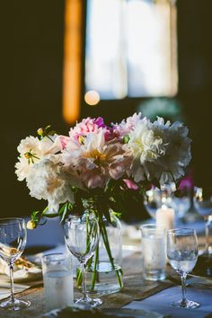 large glass jar centerpiece // photo by Amber Gress // View more: http://ruffledblog.com/boho-greenpoint-loft-wedding/