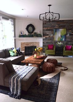 Reclaimed wood wall added immediate warmth to this room, but accessories from…