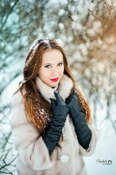 Black leather gloves in the snow