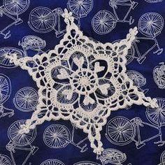 Snowcatcher: Crocheted snowflake pattern.
