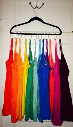 I wanted to share this (:  It's so simple & easy to do!  All I did was go to the Dollar Store and purchase a set of clear plastic shower curtains hooks! (Set of 12 for $1)   This is going to make my life so much easier when I'm getting ready and need to find the perfect colored tank top or cami to match my outfit! (: I added the hooks to a hanger, so it will hang right in my closet! Or you could add it to a long towel rack to display right on your wall (: I love being organized!!! <3