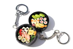 Polymer clay miniature bento box bag or purse charm...yummy (one charm)  Cute wooden tray holding selection of sushi on a silver tone bag charm  ***Sushi details may vary, but all will be in a black wooden tray***   Also available as a ring here: https://www.etsy.com/uk/listing/470474171/bento-box-ring-sushi-ring-japenese-food?ref=listing-shop-header-2  And as a necklace here: https://www.etsy.com/uk/listing/470463511/sushi-neck...