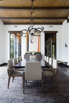 """The dining room's custom bronze light fixture by Hervé Van der Straeten is Kimmel's favorite piece: """"There is a beautiful balance in the contrast of the heavy material with the airy intersecting loops."""""""