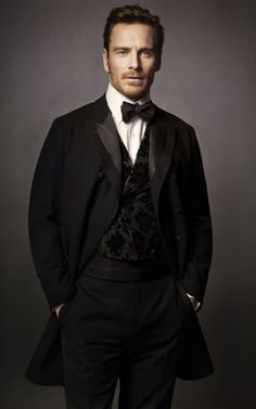 "Michael Fassbender by Henry Leutwyler for Vogue US March 2011: ""Dashing Hero"" - I don't understand why there is a cummerbund in here, it is superfluous... they should have just made the waistcoat longer and the trousers higher..."