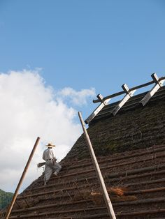 Re-thatching the roof at Miyama, Kyoto--a traditional architectural preservation area. Minka. Japanese farm house