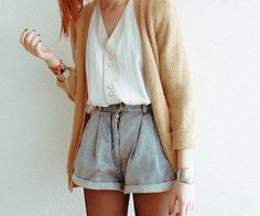 Loose high - waisted shorts with a white top and long cardigan