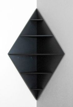 "The Diamond Corner Shelf is a unique five level shelf for a favorite corner. ""A conversation piece in any room."