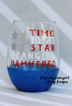 """Best patriotic wine glass ever. Stemless wine glass with """"Time to Get Star Spangled Hammered"""" on it. I like the blue glitter base. Good for a fourth of July celebration, a patriotic wedding, or a party kind of military related get together."""