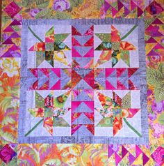 Playing with Deb Tuckers ruler and Kaffe Fasset fabs