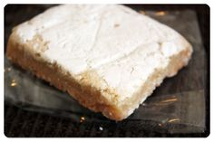 June 2014 Orange Glad: Fine Sconehenge Baking Co. Luscious Lemon Bar. This handmade, all-natural treat features a luscious, light lemon layer dusted with powder on top of a rich, shortbread crust . One word: INCREDIBLE. Price: USD $2.50/each -- #orangeglad #desserts #sweets #subscriptionbox #foodie #food #snacks #artisan