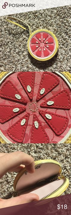 Coach summer collection round wallet Coach wallet in a shape of a grapefruit small and perfect for a travel purse. Perfect for summer Coach Bags Wallets